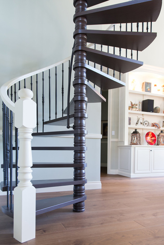 The spiral stair was definitely a huge factor in this reno and took some thought and research. The existing design needed a facelift to keep in fashion with rest of the home. These staircases are unique in that they reduce the use of space while adding such a incredible look. Iron replaced the wood and paint was renewed.