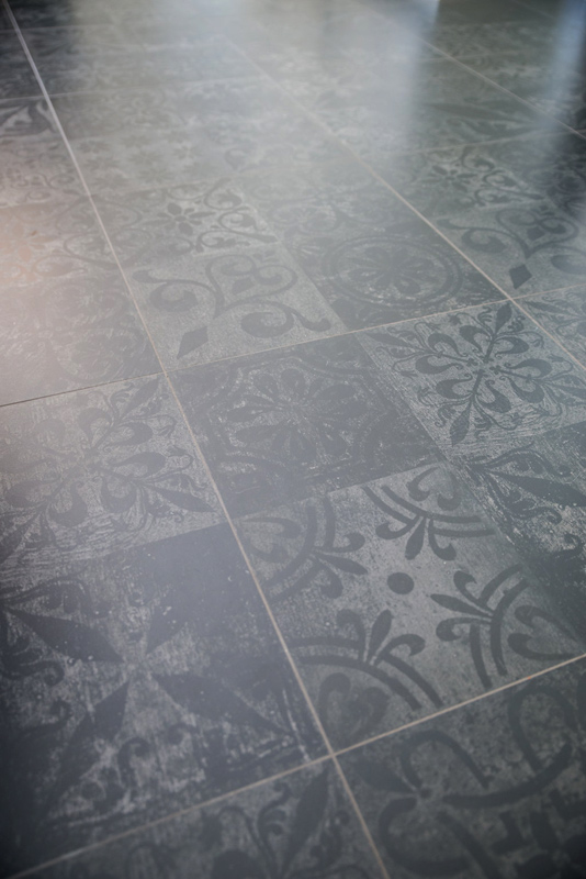 This one of a kind tile in the kitchen defined the space from kitchen to living area.