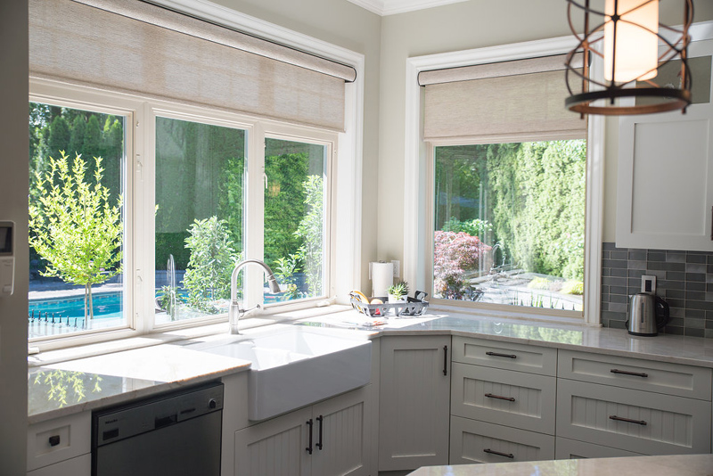 Roller shades replaced traditional fabric topper and updated this home with a clean look.
