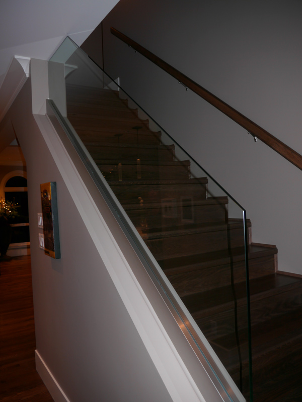 Glass made this staircase feel more open and really worked....