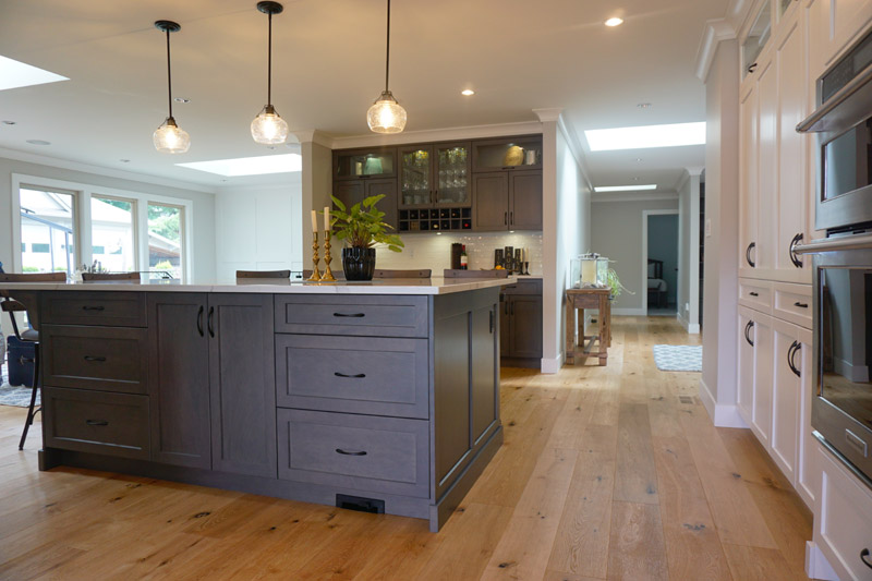Warm wood flooring continues throughout many areas of this home.