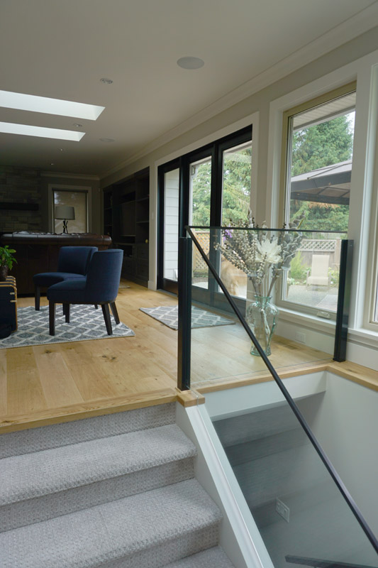 Glass railings help retain the feeling of open space.