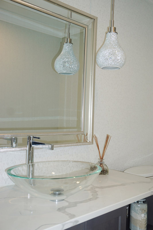 Main floor powder room with a stunning crushed glass pendant light.