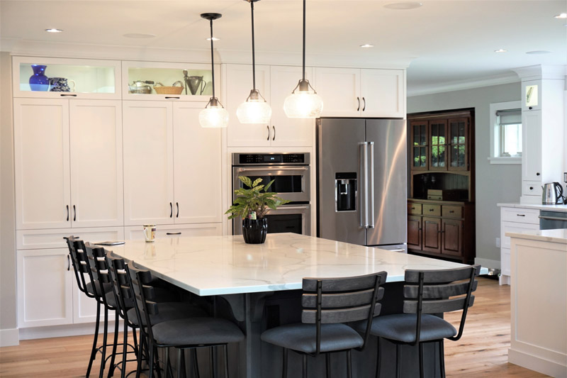Marble counter tops and white cabinets add to the clean lines of this home.