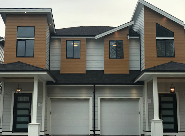 Non Strata duplex style home..2400 square foot 2 level plus basement. Boasts hardie exterior with metal cedar accents