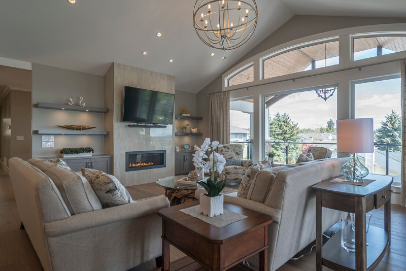 The blinds/drapes add the finishing touch to any room, while allowing the full windows to bring in the light during the day and then at night making rooms cozy and warm.