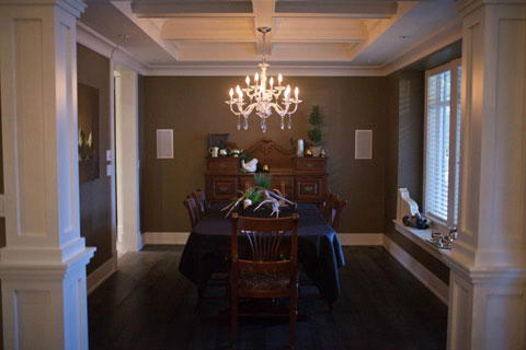Coffered ceiling makes this dining space more intimate.