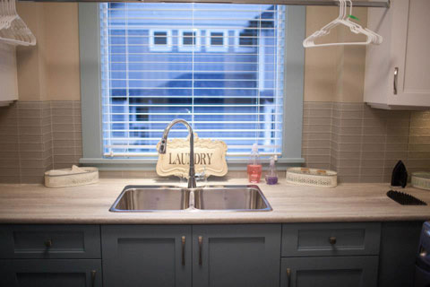 Lets retreat to the laundry room. The two tone blue/white make this space calm and inviting.