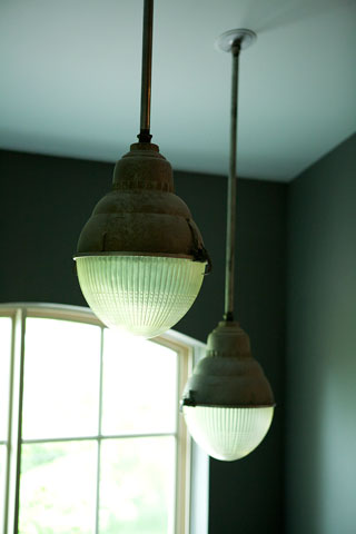 These aging 1940's industrial Montreal street lights were exactly what I was looking for. I turned their world upside down and added a pole and they made charming hanging lights over my iron stairway.