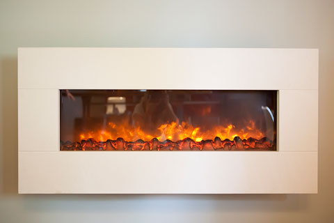 This wall mount electric fireplace made of limestone completes the area and spills warmth.